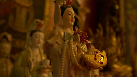 Guanyin or Guan Yin East Asian bodhisattva Statue in Temple at Wat Phanan Choeng Footage