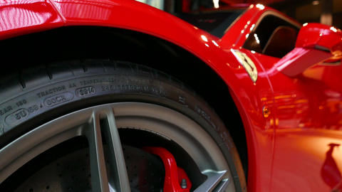 close up of Red Ferrari F430 Scuderia Front Wheel brake system with logotype. at Filmmaterial