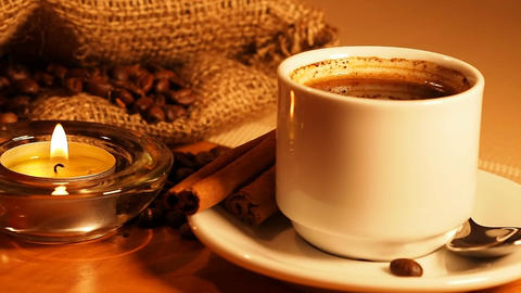 romantic background with candles, a cup of coffee and coffee beans in a bag and  Footage