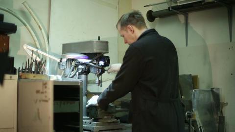 Scientist working on a drilling machine Footage