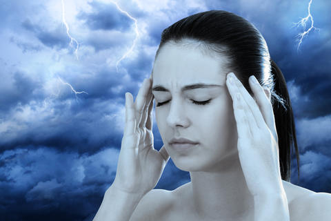 Conceptual image of woman meditating against stormy background フォト