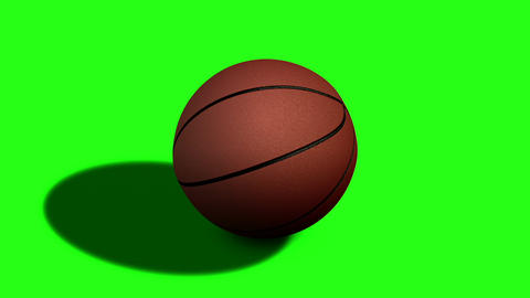 Looped rotation around classic basketball ball at green screen Image
