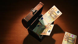 Shadow economy. 500 Euro. Money falls in the chest. Artistic background Footage
