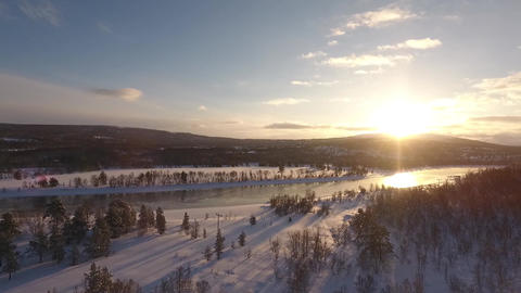 Drone flight over a northern landscape against the sun ビデオ