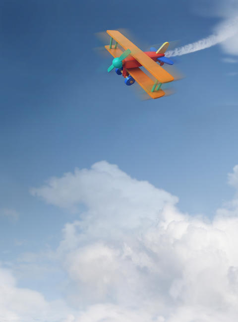 Colorful toy plane in the air フォト