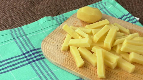 Raw potato sliced strips prepared for fries Footage