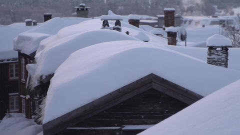Old wooden houses covered with a thick layer of snow Footage