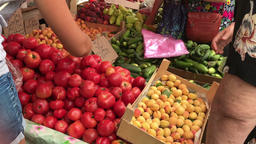 Buyers choose vegetables in the vegetable market Footage