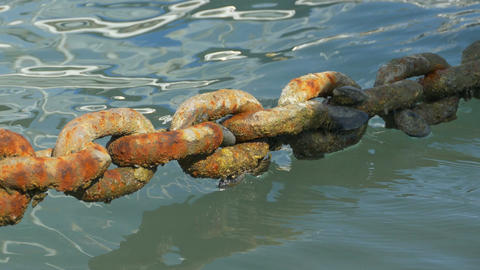 Rusty Big Chain on Water Image