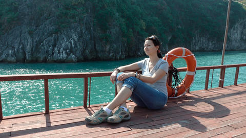 A woman admires the beautiful views of Ha Long Bay Footage