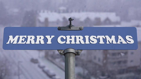 Merry Christmas road sign on cold blizzard snow winter time with 4k resolution ビデオ