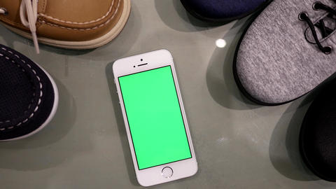 Motion of display shoes and green screen phone on table for leisure concept with Footage
