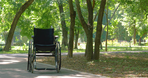 Wheelchair left empty in park Footage