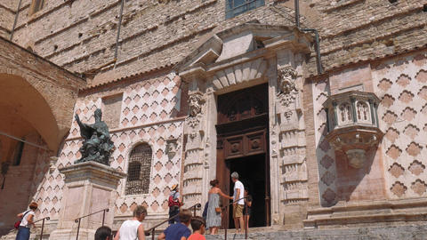 Side entrance of Perugia cathedral with Pope Julius III statue, Umbria, Italy Footage