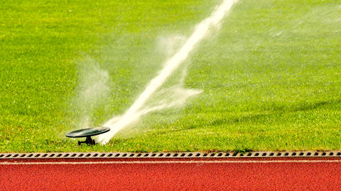 Soccer or football field irrigation system of automatic watering grass. Watering Footage