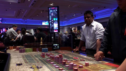 Motion of people playing casino roulette inside Hard Rock Casino with 4k resolut Footage