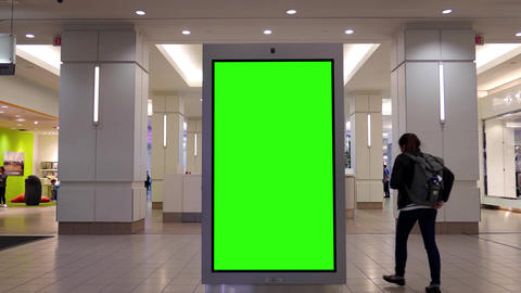 Motion of people shopping and green screen billboard in the middle inside Burnab Filmmaterial