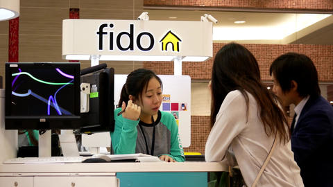 People asking fido sales clerk about cellphone plan inside Burnaby shopping mall Filmmaterial