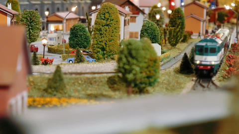 Model trains meet and cross on a diorama Footage