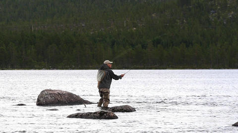 Slow motion of a fly fishing man in Norway Filmmaterial