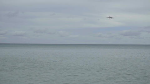 Airplane approaching over ocean Live Action