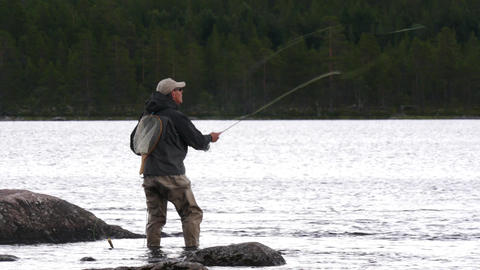Fly fishing man in a river in Norway Footage