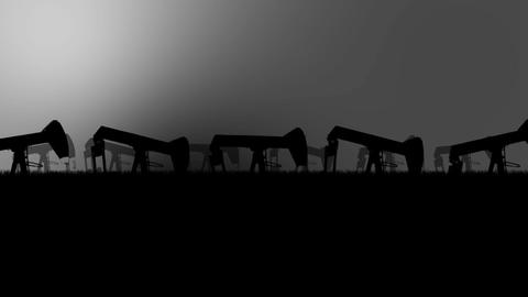Industrial Oil Pumps Silhouette in an Oil Field in a Polluted Environment Footage