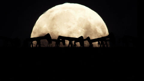 Oil Pumps on a Full Moon Background in a Polluted Environment Image