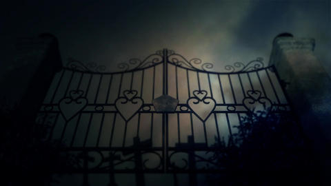 Spooky Old Metal Cemetery Gate Under a Lightning Storm with Graves Footage