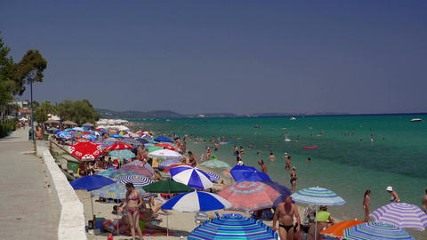Bathers on the beach on a hot summer day at Greece Image