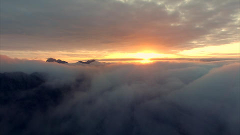 Midnight sun above the clouds on Lofoten in Norway Footage