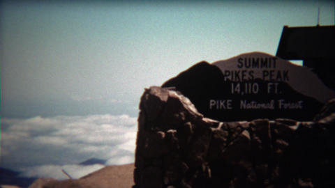 1972: Pikes Peak Summit sign and people walking past Footage