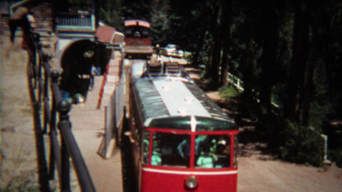 1972: Pikes Peak cog railway leaving station towards mountain peak Footage