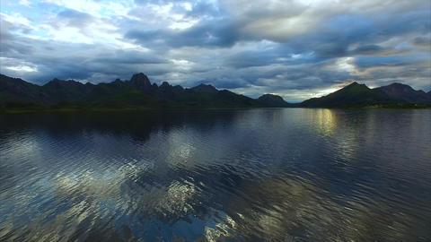 Slow flight above fjord waters on Vesteralen islands Footage