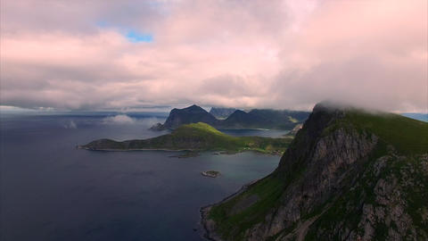 Flying in clouds by the cliffs on Lofoten islands, Norway Footage