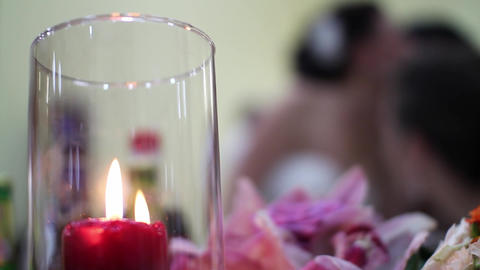 Candle burns in a glass bowl at the wedding party of a new family 6 Footage