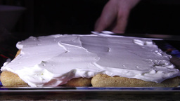 Mother prepares a festive cake. The cake is made of ladyfingers, cream and raspb Footage