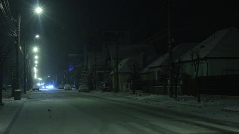 One winter evening when it was snowing outside cars passing on the street 3 Footage