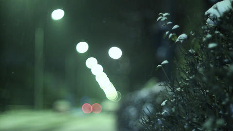 One winter evening when it was snowing outside cars passing on the street 7 Footage