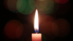 Candle with black background that is seen Christmas lights 2 Footage