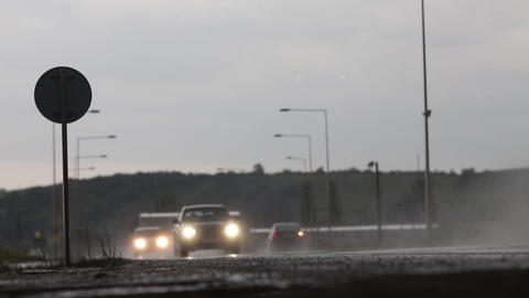It is night cars with headlights on driving on hurrying because he got rained 1 Footage