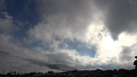 Winter landscape. Fluffy white clouds moving over blue sky. The hills are covere Footage