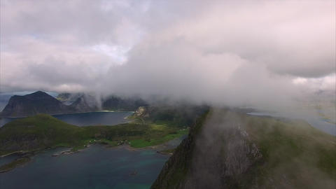 Flying into the cloud over the peak on Lofoten islands, Norway Footage