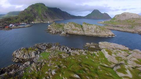Flying above rocky islands on Lofoten islands in Norway near Mortsund Footage