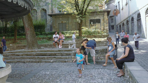 People relaxing at the iconic Bergamo old washing place Footage