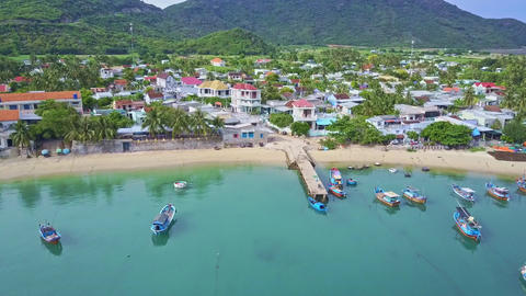Camera Flies over Wonderful Quiet Bay to Beach and City Footage