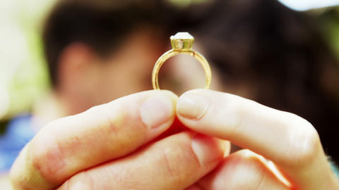 Close-up of romantic couple holding engagement ring Live Action