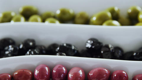 Close-up of green, black and red pickled olives Footage