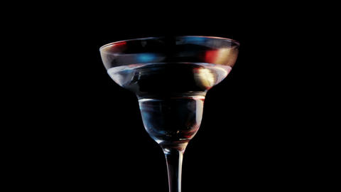 Olive stick falling in cocktail glass Footage