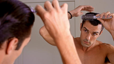 Athletic Man Combing Hair Footage